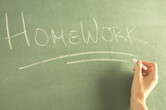 Homework written on blackboard